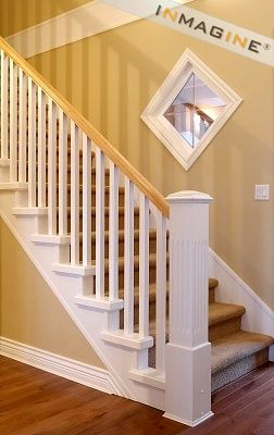 Banister With Wood Floor And Carpeted Stairs I Think