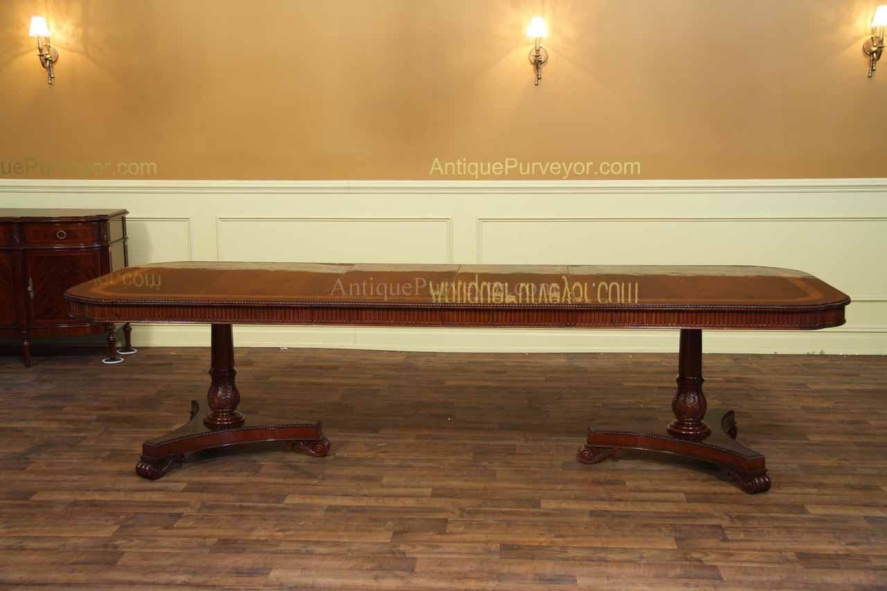 10 foot mahogany dining table for 10 to 12 people shown with 2 leaves in