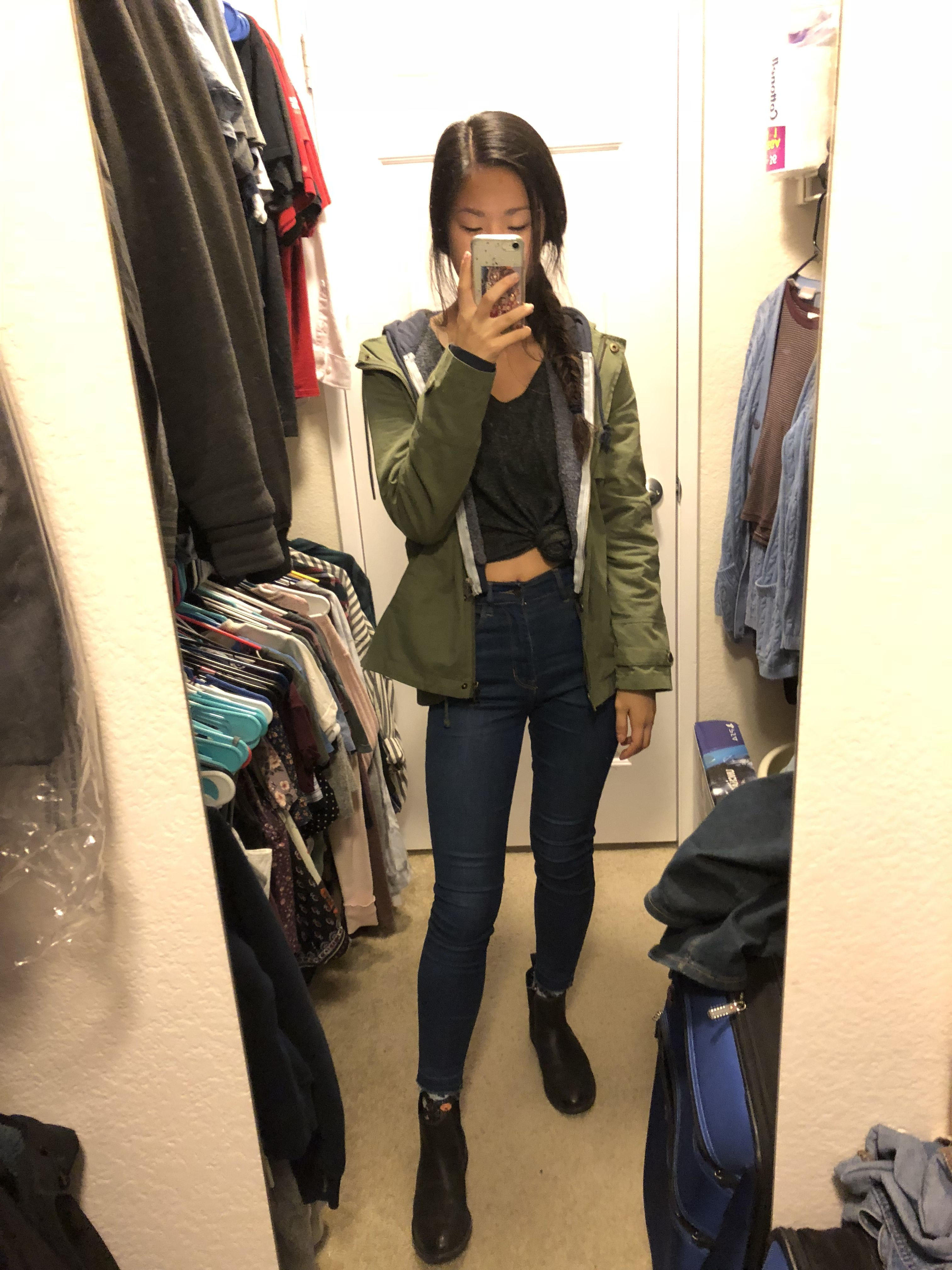 Layered outfit: high rise jeans, hoodie, olive utility jacket