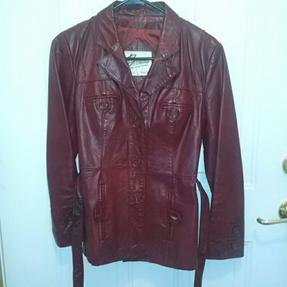 Leather jacket Vintage leather jacket. Says size 10 but fits like a small. In very good condition, a little rubbing behind the buttons but not noticeable. No funky smells. Buttons like a blazer and has a tie waist. Maroon-ish in color Jackets & Coats Blazers