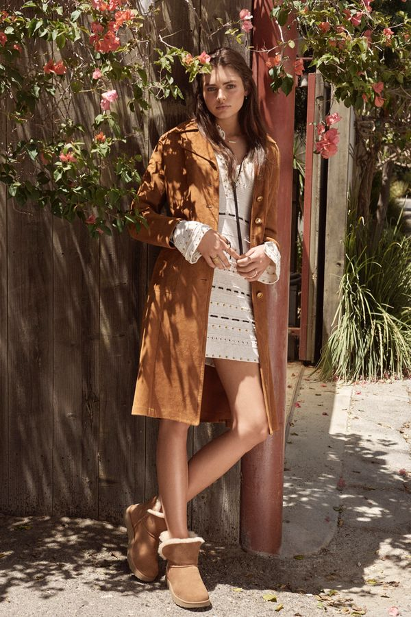 6326c9c3927 Play with proportion by layering a longline jacket over a long-sleeved mini  dress