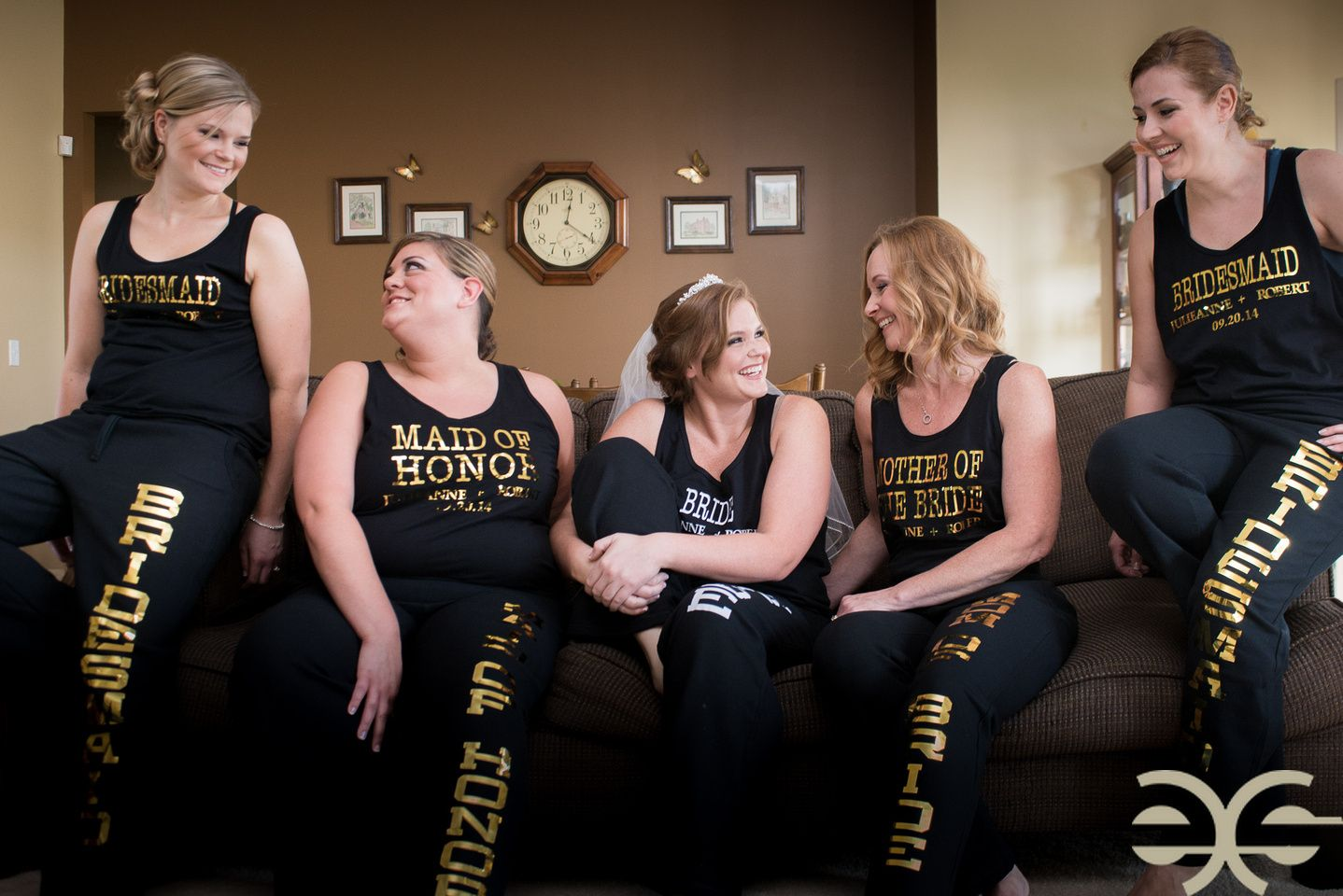 Bride and bridesmaids hanging out in personalized sweat suits ...