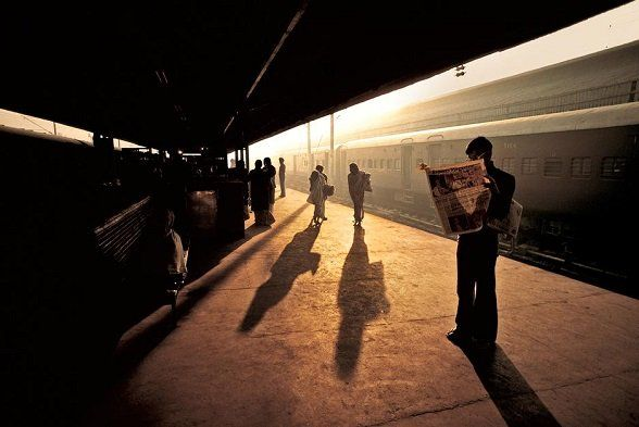"""""""People don't take trips, trips take people."""" – John Steinbeck  ©Steve McCurry Train Station at Old Delhi INDIA 1983"""
