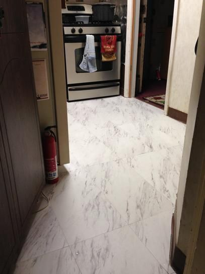 Trafficmaster 12 In X 24 In Peel And Stick Carrara Marble Vinyl Tile 20 Sq Ft X2f Case Ss1212 At Th Vinyl Tile Marble Vinyl Luxury Vinyl Tile Flooring