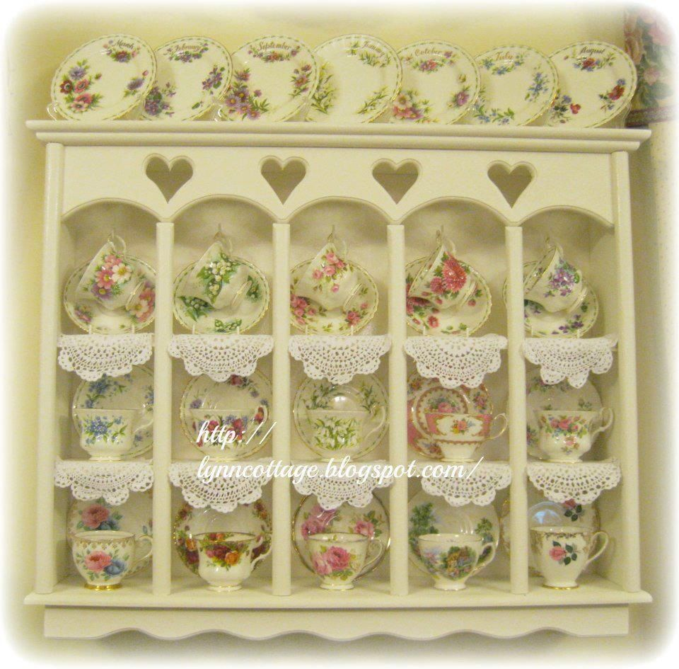 Antique tea cup collection displayed in a cute little cabinet ...