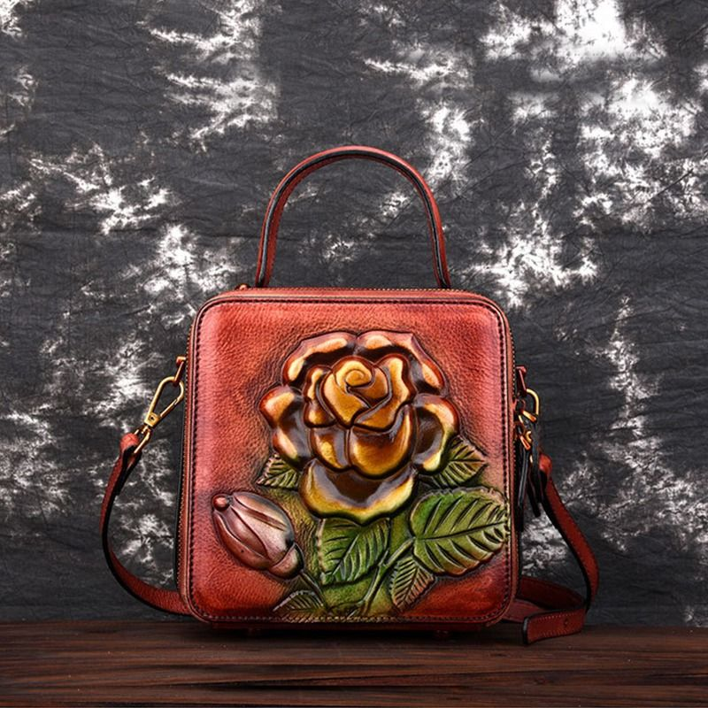 MACH MOMINS ZUMBO HANDMADE ROSE EMBOSSED LEATHER MESSENGER SQUARE BAGS   #travelinstyle #travel #leatherhangbags #fashionbags #lindaikeji #airportstyle #airportfashion #airportoutfit #luggagetags #luggage #business #nigerianwedding #nigerian #quality #wizkidnews #wizkidayo #davidoofficial #theluggagestore #tontolet #squarebags #newcollection #handbag #clutch #slingbag #combo