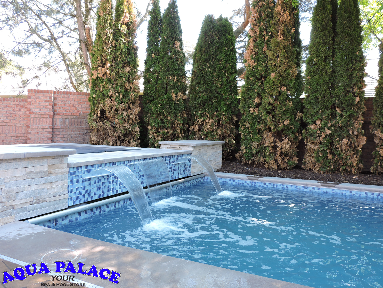 Fiberglass Inground Pool With Custom Water Features Tile And Auto Cover Enjoy The Hot Tub While Overlooki Custom Water Feature Pool Inground Fiberglass Pools
