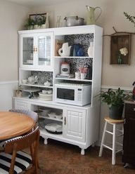 Add Tons Of Storage With A Functional Practical Kitchen Hutch This White One Cleverly Hides The Microwave Amongst Pretty Serve Ware