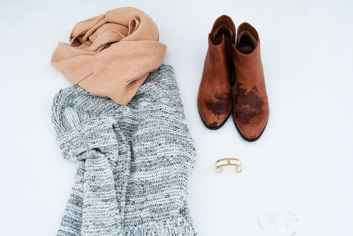 style essentials: gray sweater, rose scarf, and worn-in leather boots.
