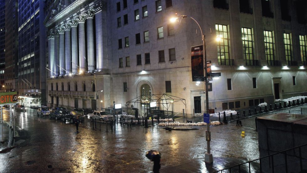Sand bags protect the front of the New York Stock Exchange, Monday, Oct. 29, 2012