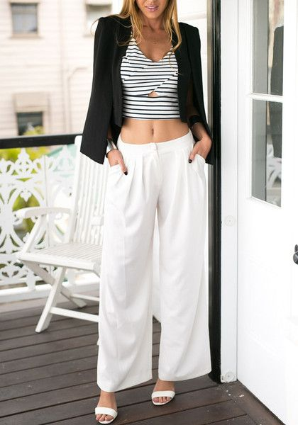 Take it back to the classics with these white pleated wide leg pants.