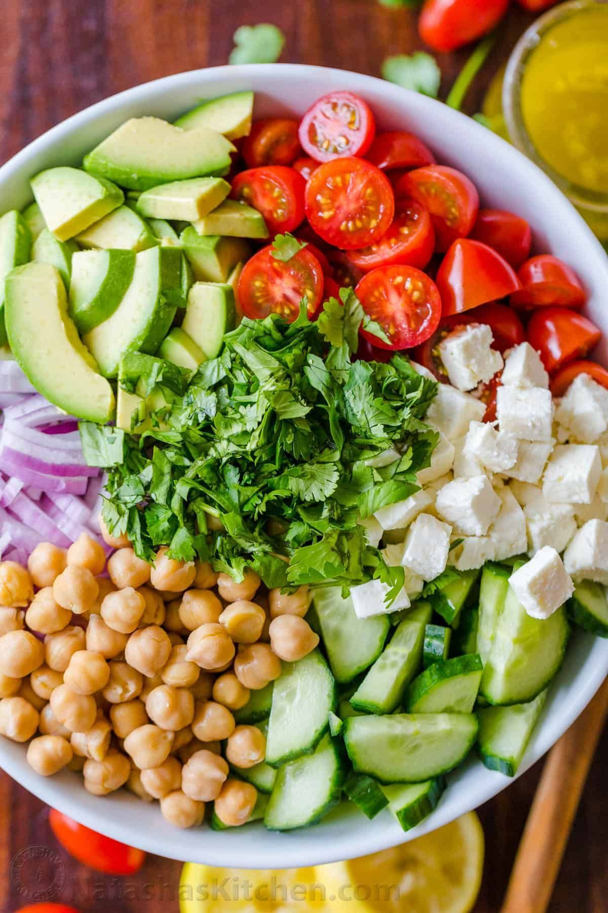 loaded with crisp cucumbers, juicy tomatoes, creamy avocado, feta cheese and chickpeas or garbanzo beans. Fresh, healthy and protein packed!