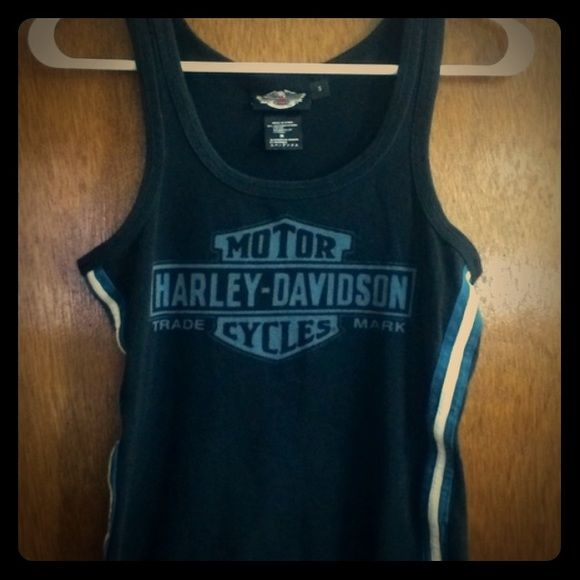 Harley Davidson shirt Super cute and chic. Don't fit me. I wear this twice. Not any city names in the shirt. Only says Harley Davidson. Perfect condition. Harley davidson Tops Crop Tops
