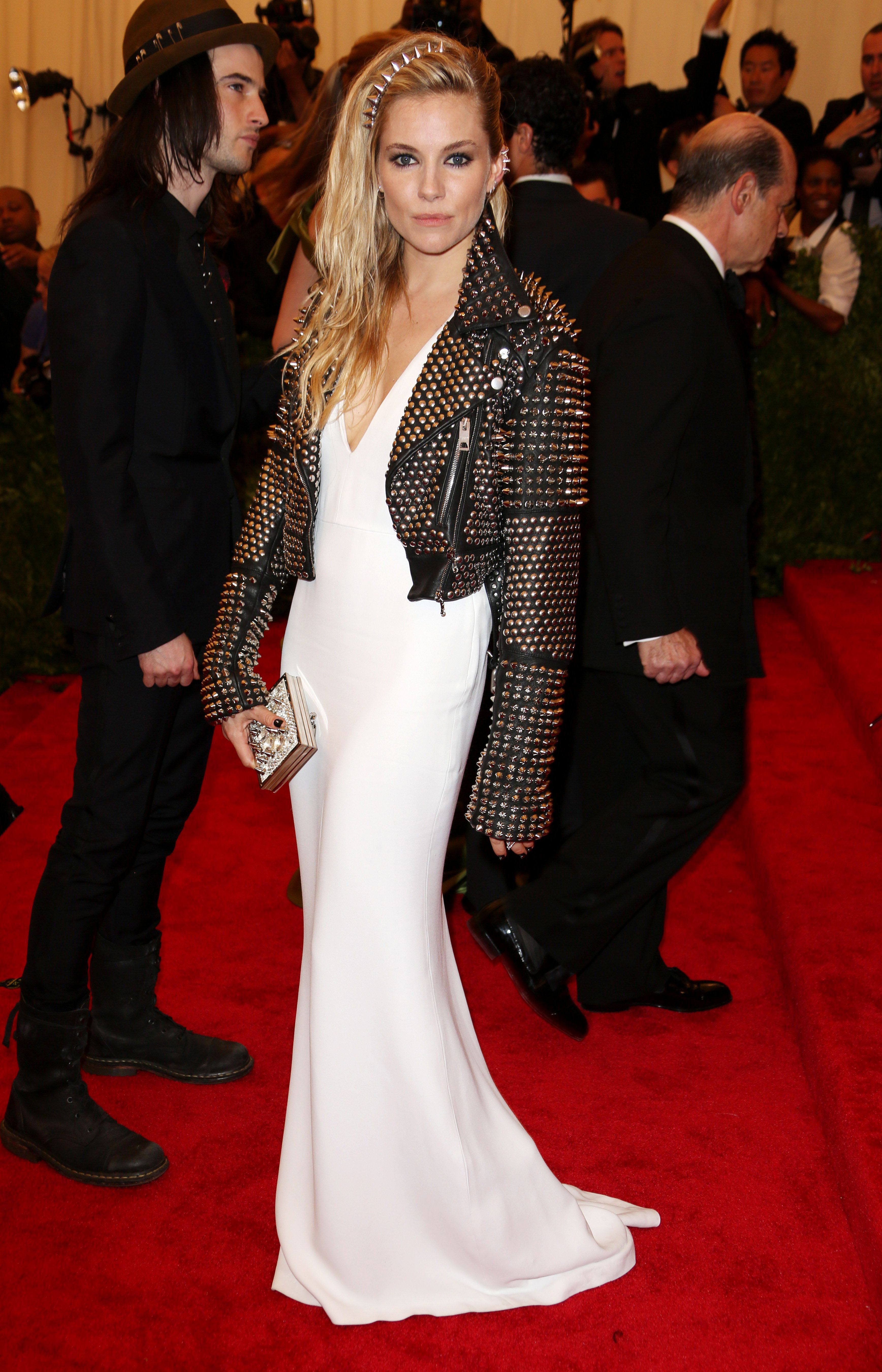 British actress Sienna Miller wearing a Burberry dress and studded leather jacket to attend the Met Gala in New York