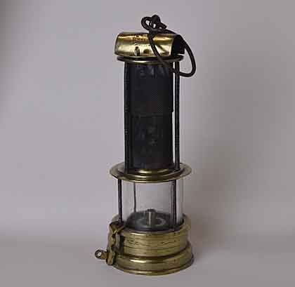 A Photo Of A Brass Glass And Gauze Miners Lamp Lamp Campaign Furniture Oil Lamps
