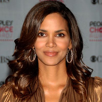 Halle Berry  THE LOOK Low curls  HOW-TO Curl hair from the ears down, wrapping small sections around a vertically held one-inch iron. Lightly shake head to give hair movement after applying hairspray.   INSIDER TRICK N.Y.C. stylist Kevin Mancuso says that because humidity brings out curls, wavy styles are easier to maintain than pin-straight hair in sticky weather.Cricket 7000 Series Curling Iron, 55; folica.com.