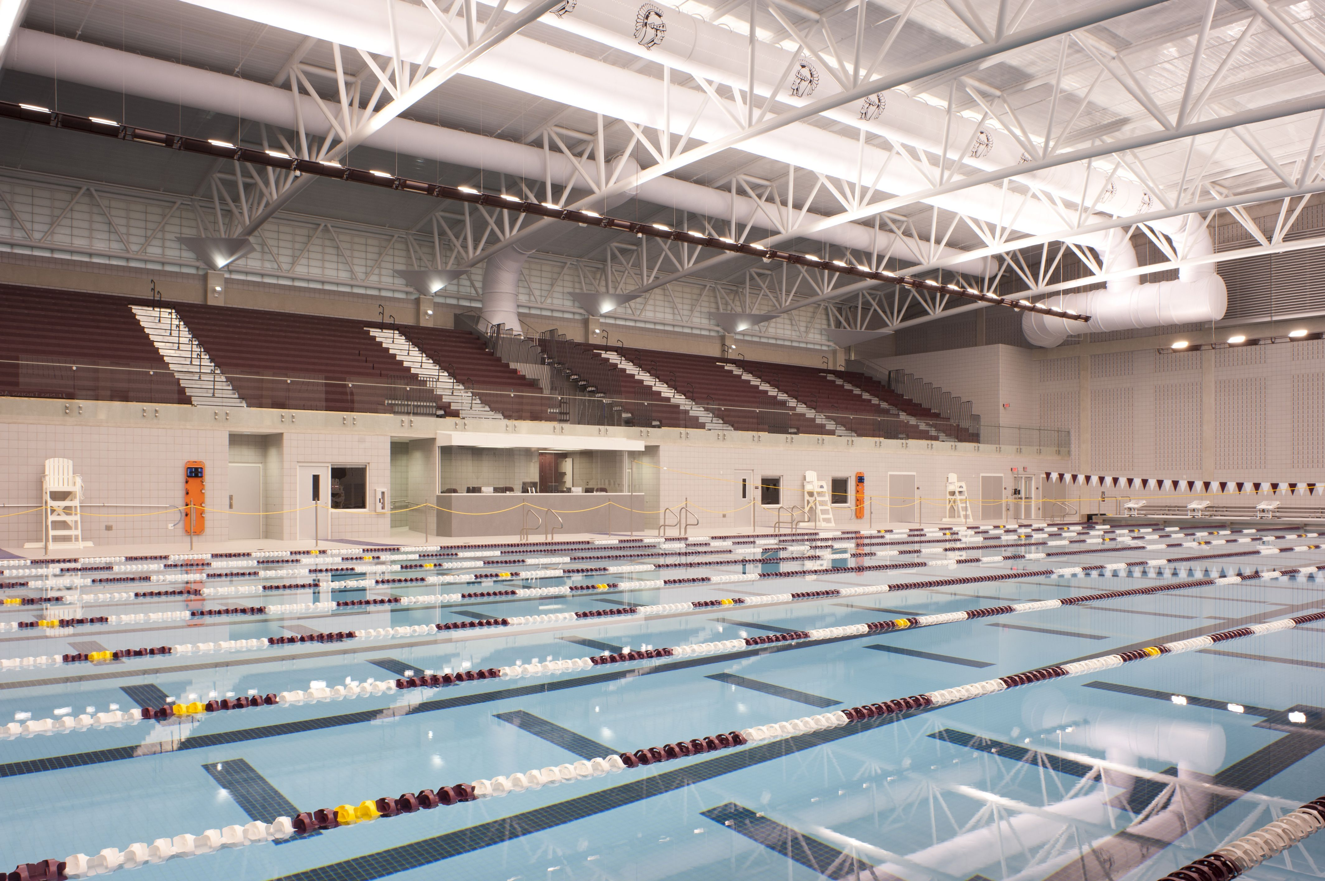A 1200 Seat Spectator Seating Area Is A Key Feature For This Competition Pool For Jenks Public Schools Design Stadium Architecture Stadium Design Gym Interior