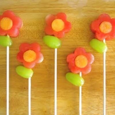 Fruit flowers, watermelon, cantelope, grapes, & plastic sticks. Adorable!
