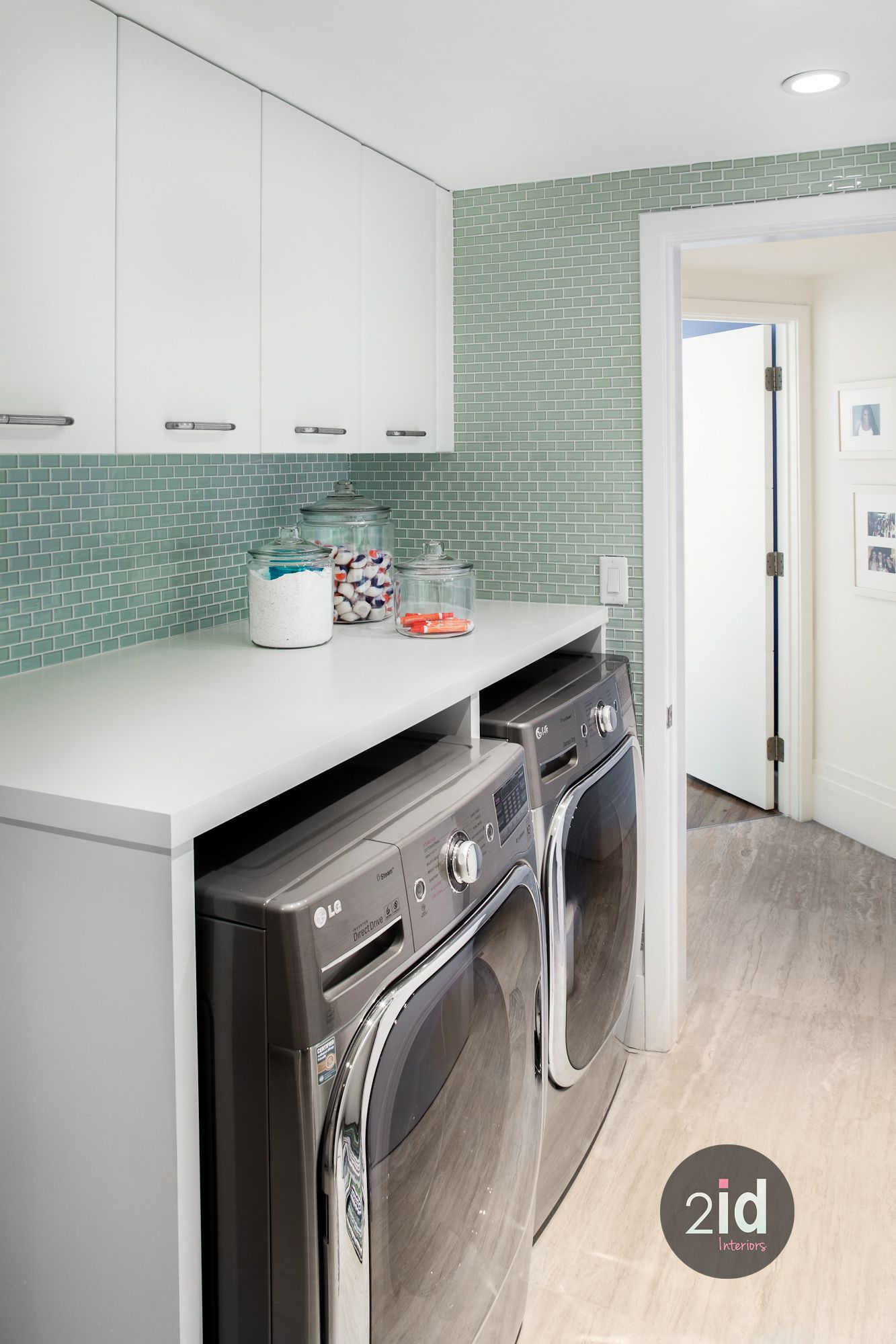 Beautiful Laundry With Stainless Laundry Machines And White Quartz Countertop Love The Aqua Mosai White Laundry Rooms Modern Laundry Rooms Laundry Room Design