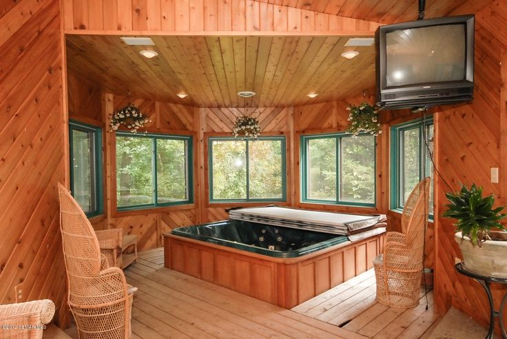 Indoor hot tub with fireplace tv in a room with a door for Indoor bathroom hot tubs