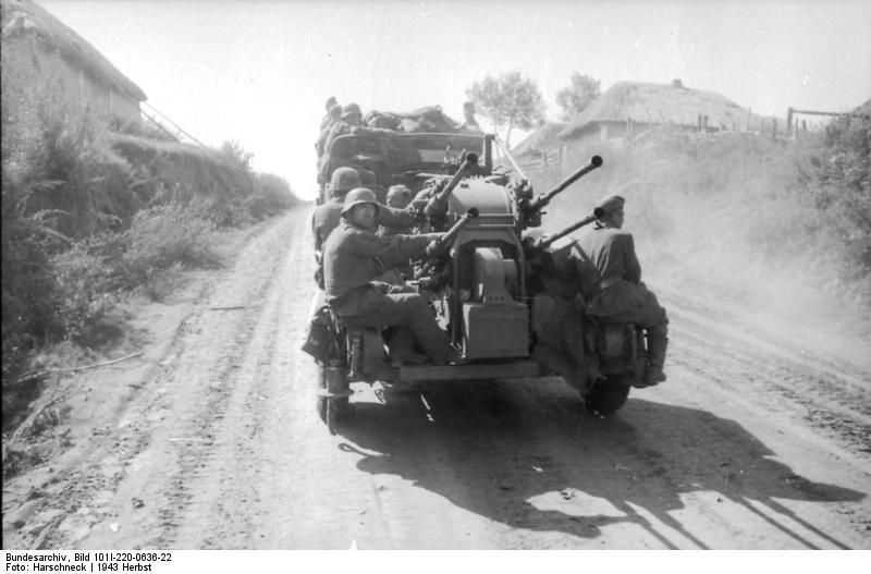 A Sd.Kfz. 6 towing a 2 cm flakvierling on a dirt road in the Soviet Union at the end of summer 1943.