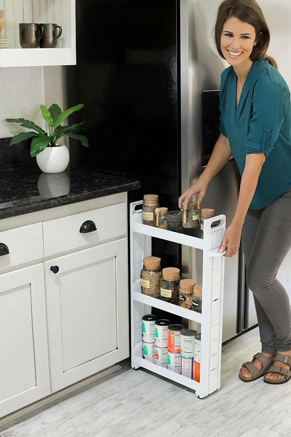 26 surprising uses for the small spaces in your home with images kitchen pantry cabinets on kitchen cabinets pantry id=64317