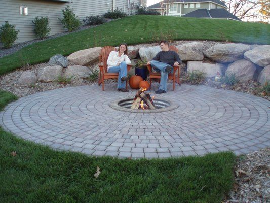 Boulder Retaining Wall With Firepit In Paver Circle Yelp Stone Patio Designs Fire Pit Backyard Sloped Backyard