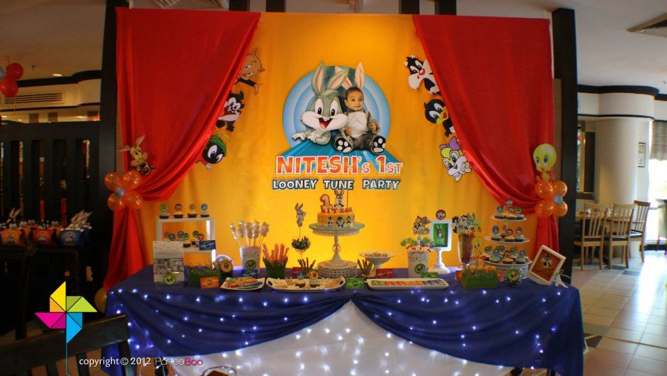 Backdrop and cake candy table for a baby looney themed for Baby looney tune decoration