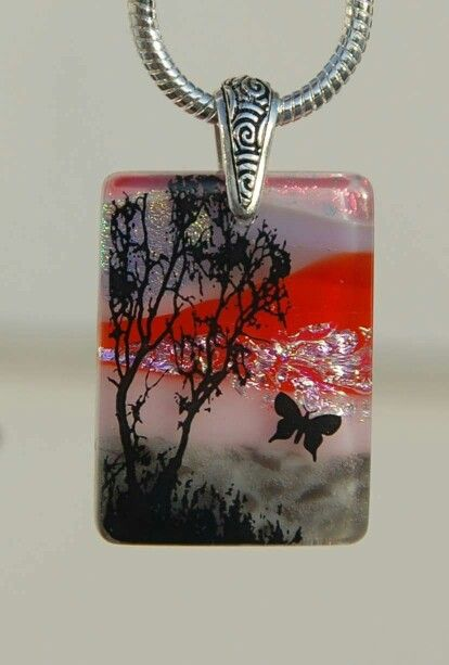 Glass landscape pendant.