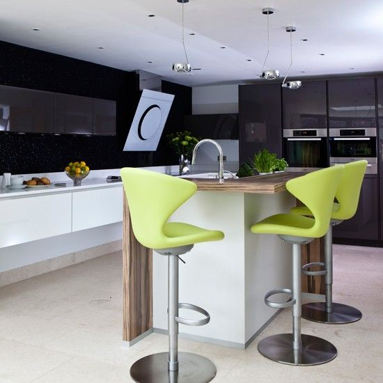 Lime Green And Black Hi Gloss Kitchen White Cabinetry Worktops Enhance The Feeling Of E While Dark Walls Units Add Wow Factor To This Modern