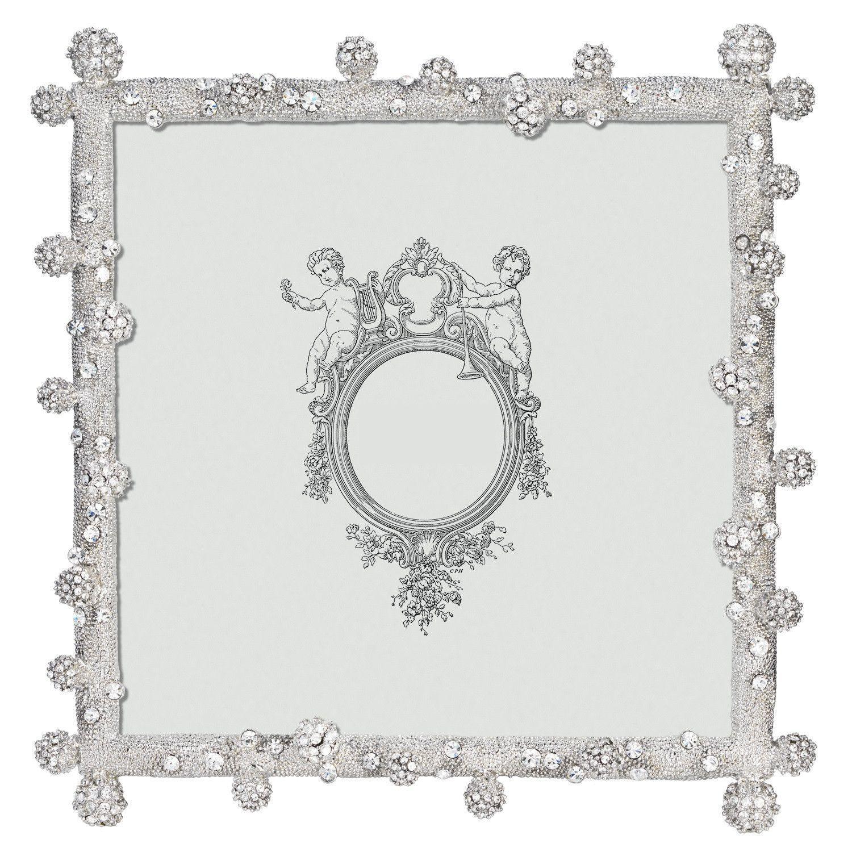 Dozens of hand-set clear Swarovski® crystal pavé clusters in cast ...