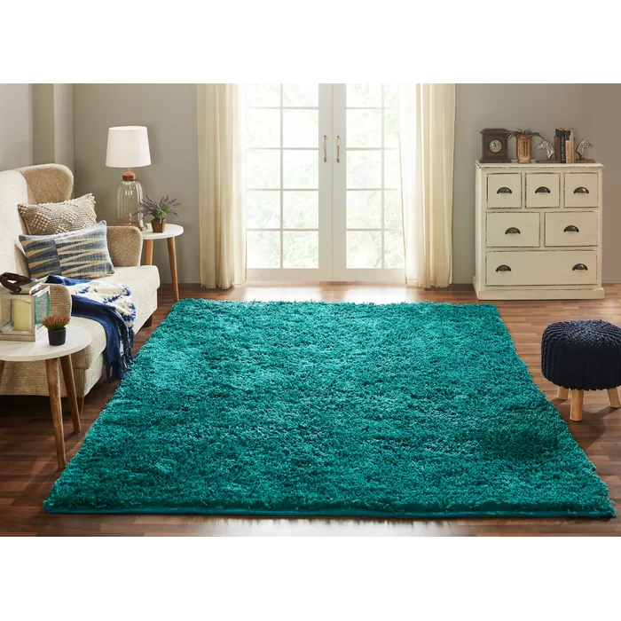 Hayfield Teal Area Rug in 2021   Teal living room decor ...