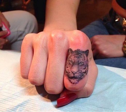 Beautiful tiger tattoo ideas best tattoo 2015 designs for Animal finger tattoos