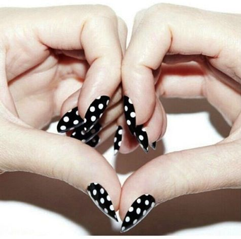 Black & white polka dot nails complement any outfit.