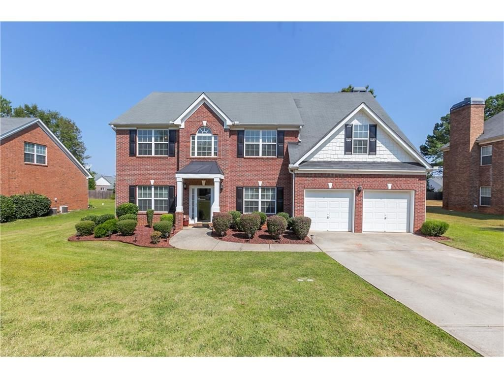 Immaculate 4 Sided brick 2 story home House styles