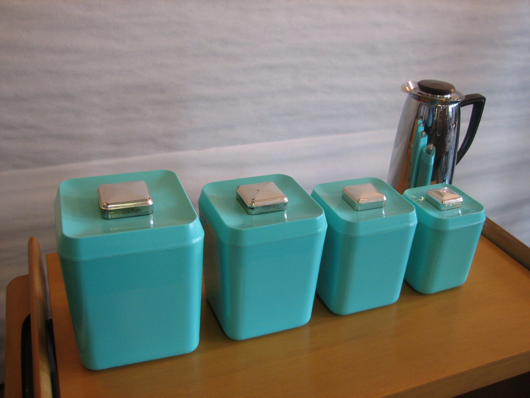 Beau Set Of Turquoise Canisters
