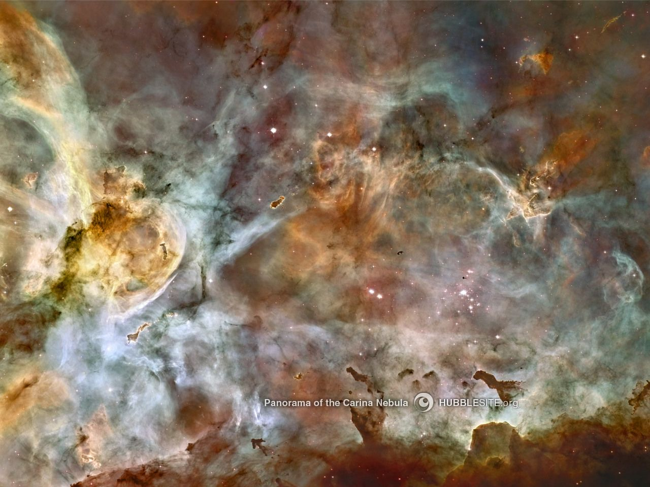 This image, released for Hubble's 17th anniversary, shows a region of star birth and death in the Carina Nebula. The nebula contains at least a dozen brilliant stars that are 50 to 100 times the mass of our Sun.