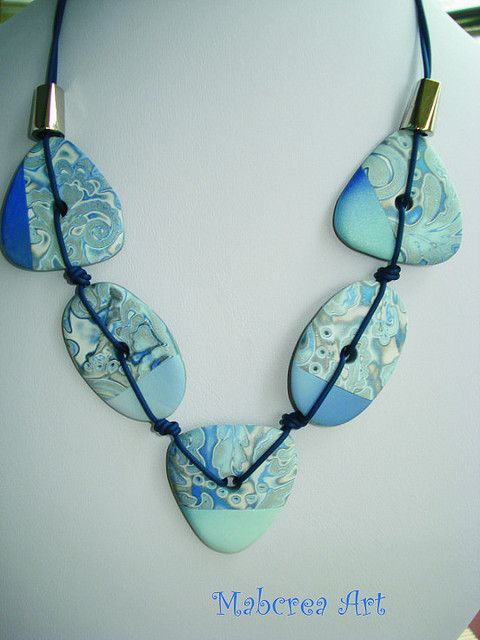 Mabcrea, mokume gane necklace made from polymer clay.