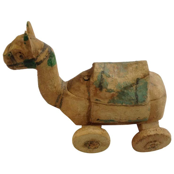 Wooden toys on wheels Camel