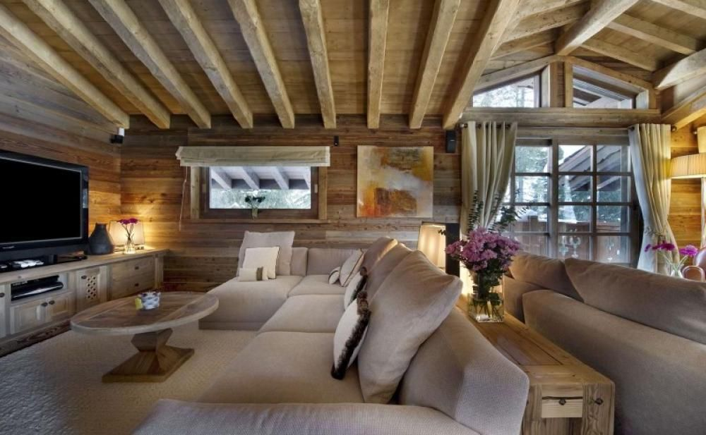 Second Floor Living Room Area With Tv And Good Air Circulation In Cold Climate Exposeb Wooden Beam Ceiling