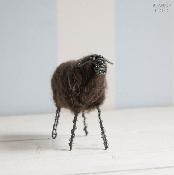 The wired sheep from black wire and dark wool from Czech sheep Valaska, from Jeseniky Mountains. Wool is felted firmly, but not hardly.  Dimensions: height x length approx 12x14 cm.  Each sheep is original, therefore, it can be a little different.  This product owns Czech trademark: Jeseniky - original product