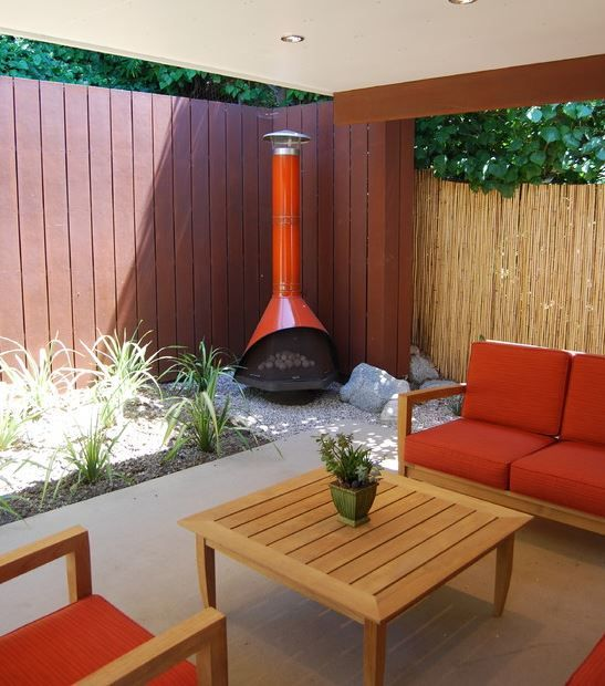 this free-standing mod design fireplace can be used with wood or gas