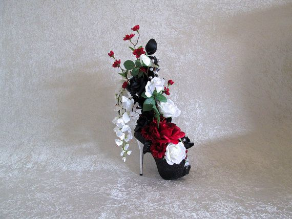Black and white rose floral arrangement in a ceramic black and white silk flower arrangement with red white and black roses in a high heel shoe wedding centerpiece silk floral arrangement stiletto flowers mightylinksfo