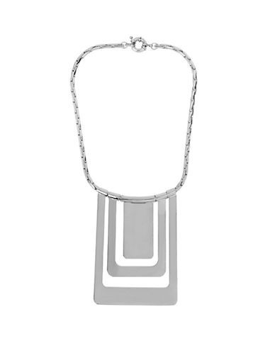 From the Metal Chain Links Collection. Sleek, silvery cutouts in a concentric motif make a play on modern mechanics.