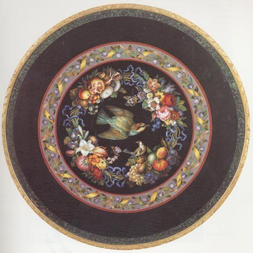 FOUR SEASONS MICRO MOSAIC TABLE, Rome, 1839, Signed Camillo Poggioli. (Diameter of Tabletop: 31 in ; 78.7 cm) A mosaic tabletop with flowers  fruit representing the 4 seasons. Two birds are shown: the larger is a European Bee eater,  the smaller bird, a European Goldfinch. The realistic texture of the birds' feathers demonstrates the potential of micromosaics for naturalistic representation in art. It is signed in tesserae, Poggiolo f. 1839 in Roma [Poggioli made it in 1839 in Rome].