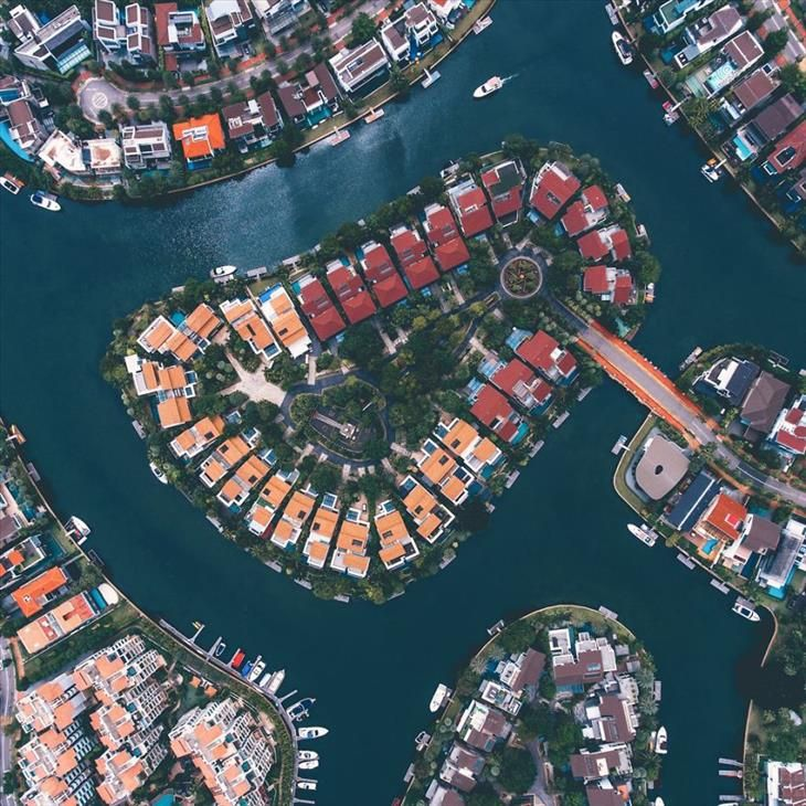 Singapore An Aerial View Of Sentosa Cove A High End Residential Development Largely Built On Reclaimed Land Aerial Photo Singapore Aerial