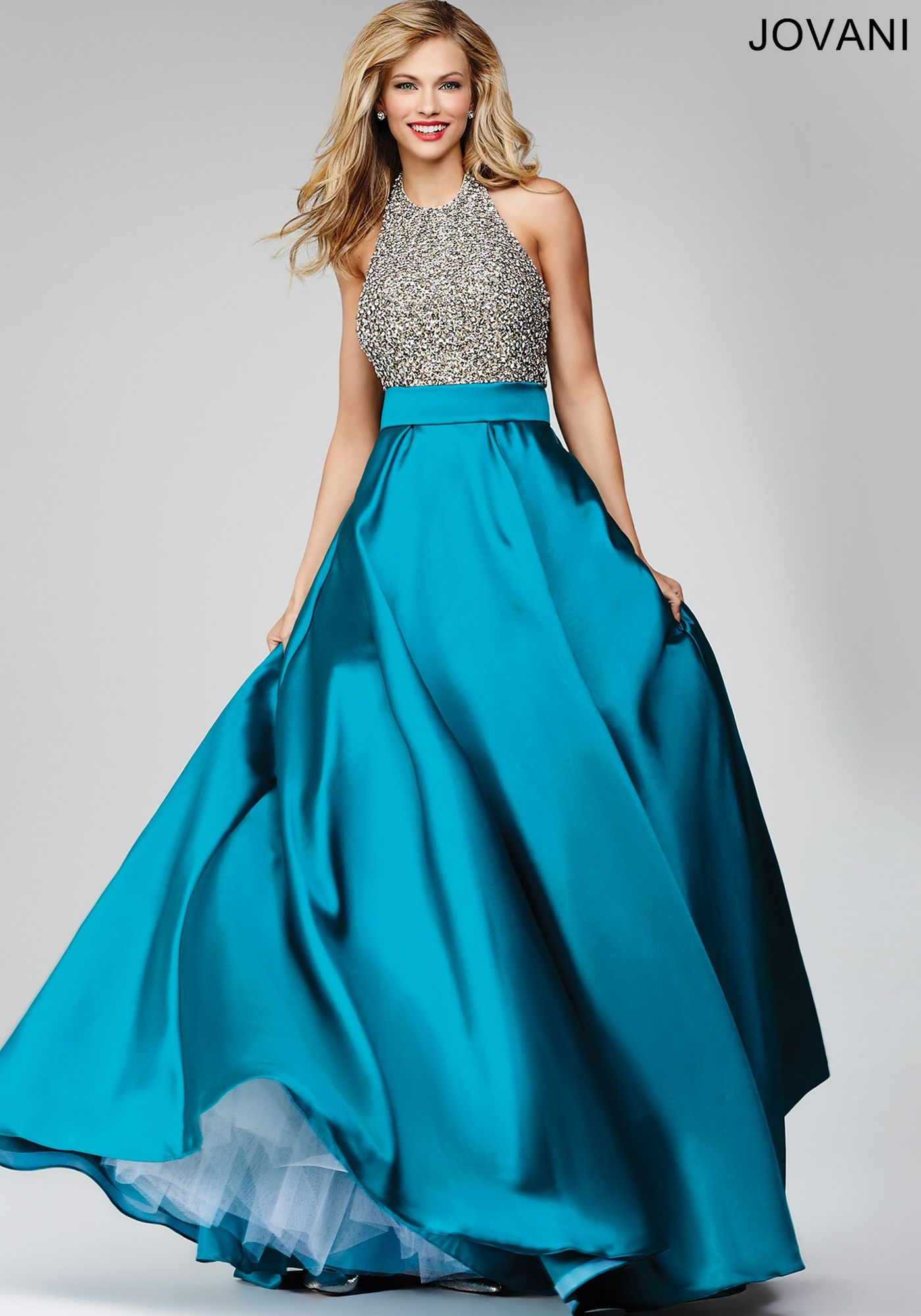 Elegant A-line prom dress features a crystal embellished bodice ...