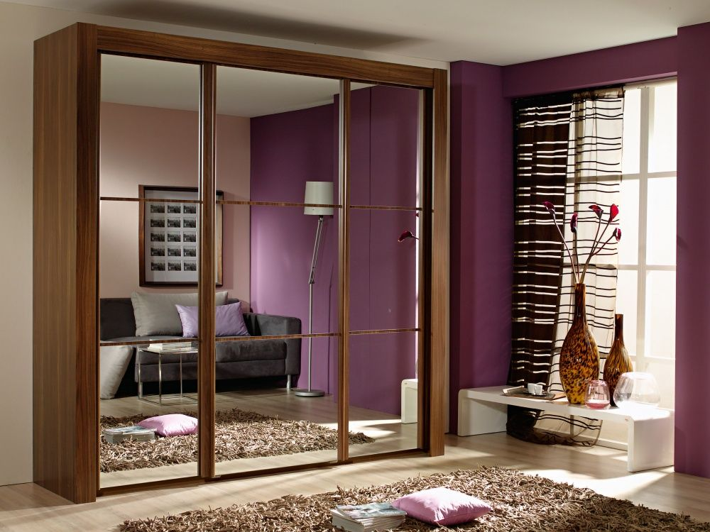Mirrored Sliding Door Design Bedroom Wardrobe With Purple Wall And Unique Curtain