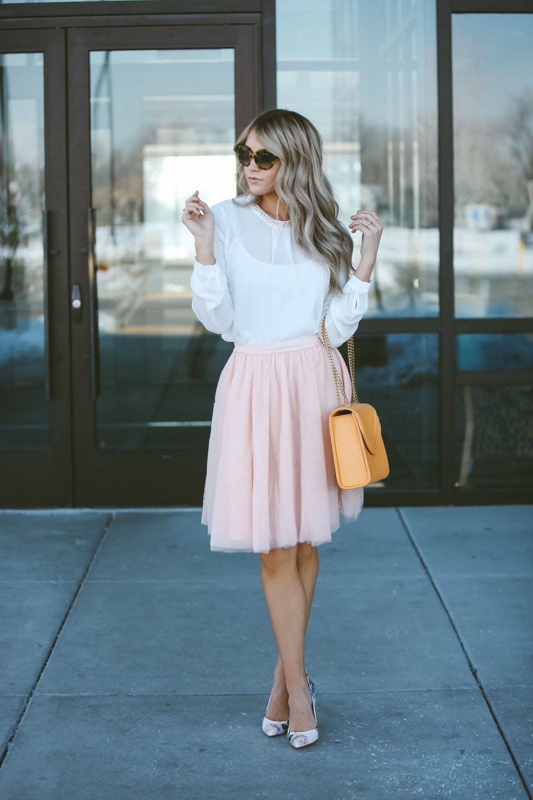 c32d5b979 Cara Loren looks effortlessly feminine in this pale pink tulle skirt, worn  with a sheer white blouse and a pair of petite matching heels.
