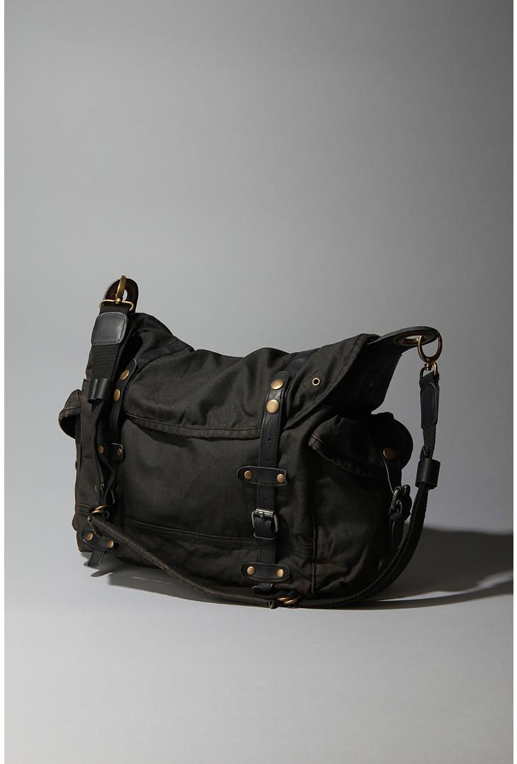 Reasonably priced washed canvas and leather trimmed messenger bag from Urban  Outfitters.  68 4930af9fb0c05